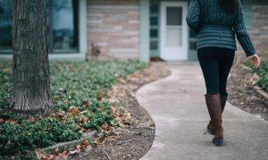 A woman walks alone