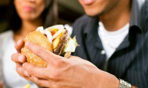 Man holding a burger