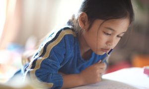 Young Asian girl reading
