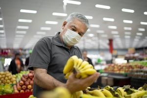 Man with mask in a supermarket